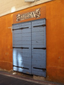 The side door to La Strega is a restaurant serving Corsican food - 'strega' means 'witch' in both Italian and Corsican
