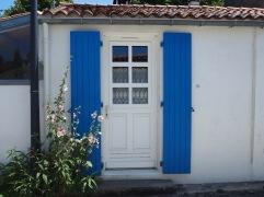 Doorstep hollyhocks in Angoulins