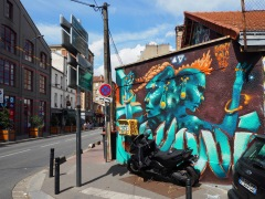 Street art, both commissioned and unofficial, brightens old warehouses and market buildings