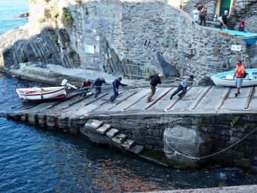 Hauling a traditional fishing boat up the slipway in Riomaggiore