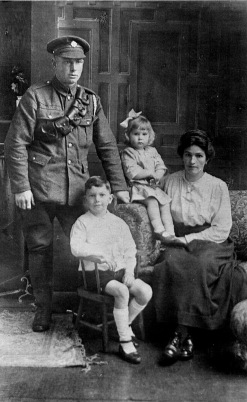 Alice and Charles (Jim) Beasely with two of their children about 1918