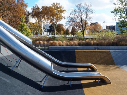 Subtly coloured safety surfacing helps play areas blend into the park landscape