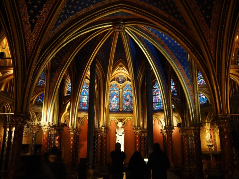 The lower chapel of Sainte-Chapelle with a statue of Louis IX, later recognised by the Catholic church as a saint