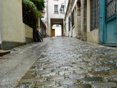 March rain in Passage des Postes - an atmospheric back street in the 5th arrondissement