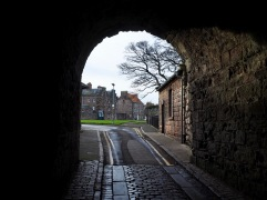 Up to the top of Church Street, turn down Parade, pass the barracks and there's a gateway in the ramparts - this is the view looking back in
