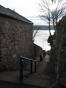 Follow the coast path round the golf course and the football pitch, pass the coastguard cottages and you come to a flight of steps down to the pier road