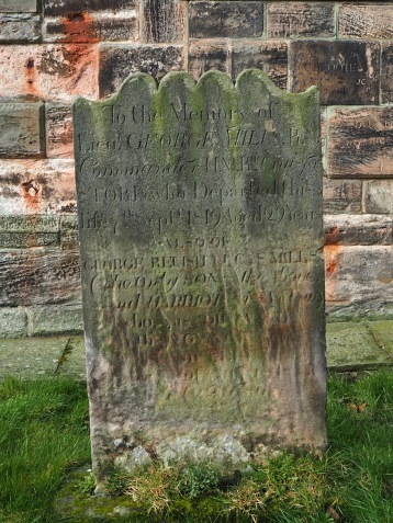 To the memory of Lt. George Mills, commander of HMR Cruiser Stork who died in 1819 aged 29 years. The worn inscription at the bottom commemorates his son, 'his pride and joy who was drowned at sea..'