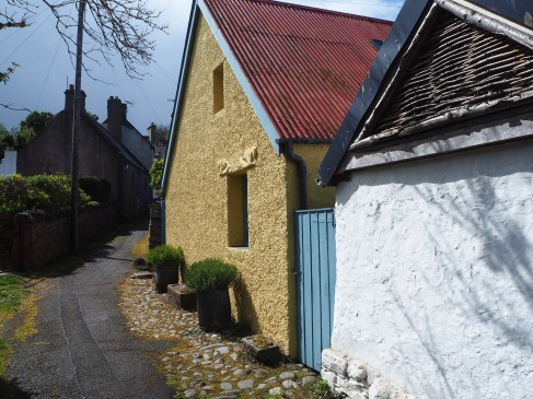 Sea blue and sandstone yellow - the cottage is called Kelpies after the sea horses carved over its window