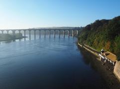 A mid-river view of Berwick's Royal Border Bridge - September 2019