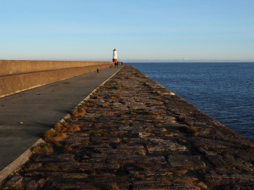 The view along the rough stone side of the pier makes a bold geometric pattern but the focal point is out of line