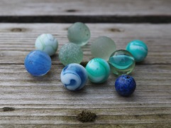 while the swirling patterns of these spherical marbles suggest they might be about to roll away.