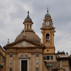 A bell tower with clock and a cross on top; a dome with cupola and a knob on top - Genoa - October 2018