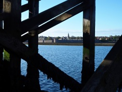 Seen from the other side of the river, framed by the timbers of Spittal's old fish quay, Berwick looks neatly enclosed and self-contained