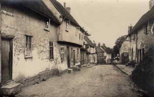 Shilling Street, Lavenham - an undated postcard, probably from the 1920s - number 21 is down the hill on the right, just before the tree